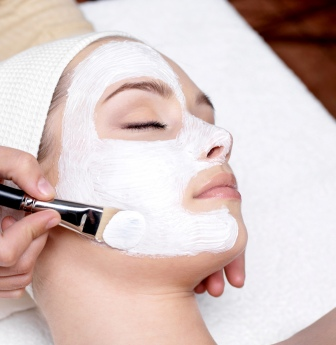 cosmetologist applying skincare treatments at cosmetology school